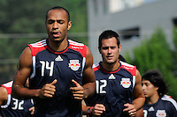 New York Red Bulls Thierry Henry (14) warms up at the start of a New York Red Bulls practice on the campus of Montclair State University in Upper Montclair, NJ, on July 16, 2010.