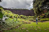 A visitor photographs the Pi'ilanihale Heiau at the Kahanu Garden near Hana, Maui.