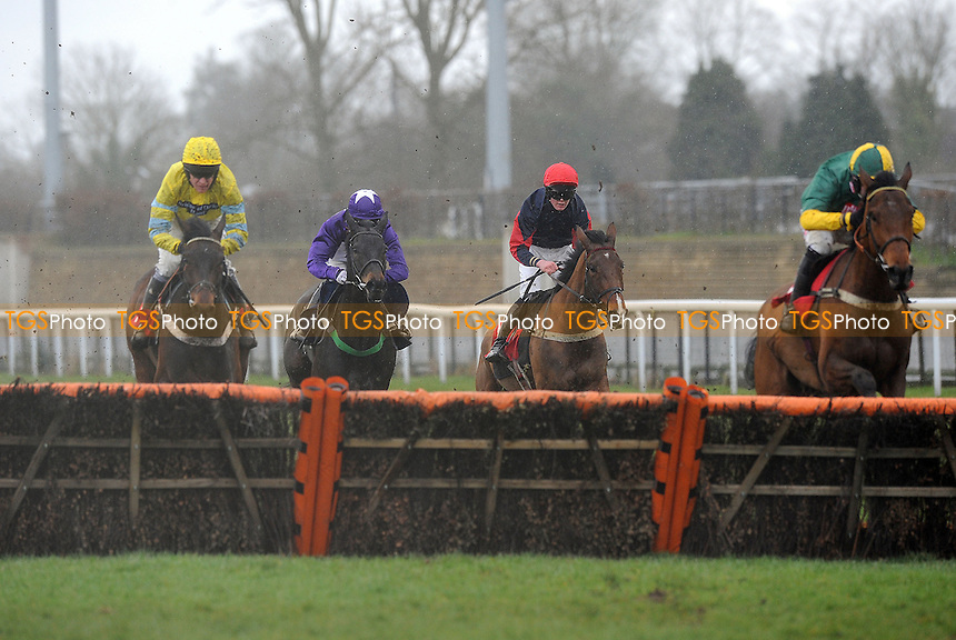 Salmanazar (extreme right) ridden by Wayne Hutchinson jumps the last and goes on to win the 32Red.com Novices´ Hurdle Cl4 - Horse Racing at Kempton Park Racecourse, Sunbury, Middlesex -16/03/2013 - MANDATORY CREDIT: Martin Dalton/TGSPHOTO - Self billing applies where appropriate - 0845 094 6026 - contact@tgsphoto.co.uk - NO UNPAID USE.