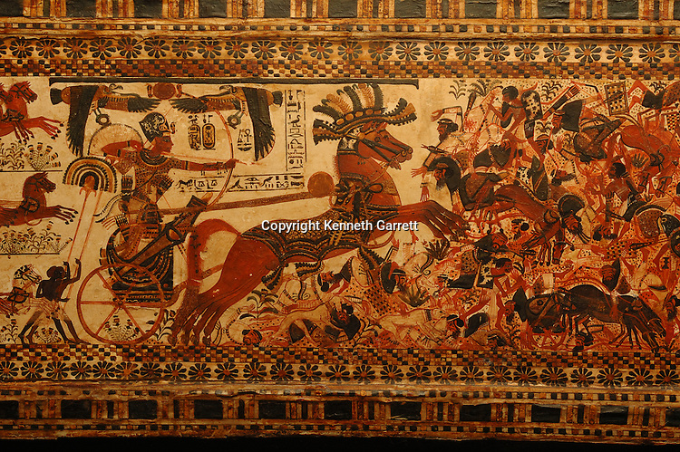 Painted box depicts Tutankhamun on chariot chasing Syrians, Tutankhamun, Exhibit, Catalog, New Kingdom, Egypt, Golden Age of the Pharaohs, Chariot, Painted, box,  artifact, bow, arrow, Tut, Tutankhamen, archaeology, Valley of the Kings, Pharaoh, 18th dynasty, Egyptian Museum, Cairo, casket