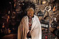 Witchdoctor Chimarizen Ranges (49) inside his 'hospital' hut. In 2007 he was possessed by the spirit 'Niagona' that prohibits him to do any work except for healing people.