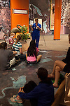 """A teacher leads a lesson for a group of students at the The """"Terra Cotta Warriors: The Emperor's Painted Army,"""" Exhibit directly from Xian in the Shaanxi Province, China which debuted in 2014 at the Children's Museum, Indianapolis, Indiana, USA"""