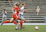 24 September 2006: UNC's Whitney Engen (r) breaks away from Miami's Kristen Chapman (l) before scoring a goal at 58:40. The University of North Carolina Tarheels defeated the University of Miami Hurricanes 6-1 at Fetzer Field in Chapel Hill, North Carolina in an NCAA Division I women's soccer game.