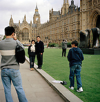 UK. London. From a story on Abingdon Street Gardens, a small patch of land, often referred to as College Green, that lies next to The Houses of Parliament in Westminster. It is a place where the media and the politicians come face to face. Interviews are held, photo shoots are set up and bewildered tourists stroll by..Photo shows tourists in and around the square..Photo©Steve Forrest/Workers Photos
