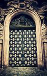 atmospheric photo of and old doorway in Prague in sepia tone