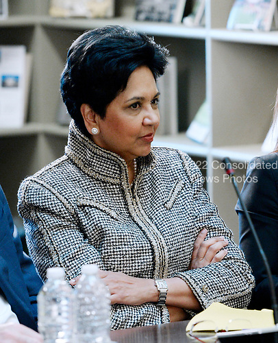 Indra Nooyi, CEO, Pepsi listens  as United States President Donald Trump speaks during a strategic and policy discussion with CEOs in the State Department Library in the Eisenhower Executive Office Building (EEOB) in Washington, DC, April 11, 2017.<br /> Credit: Olivier Douliery / Pool via CNP