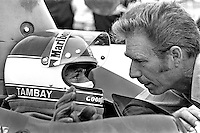 LEXINGTON, OH - AUGUST 7: Patrick Tambay of France, driver of the Carl Haas Lola T333CS HU6/Chevrolet, speaks with team manager Jim Hall during practice for the 1977 Valvoline Can-Am race at the Mid-Ohio Sports Car Course near Lexington, Ohio, on August 7, 1977.