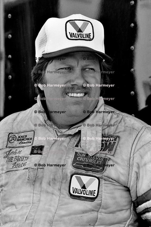 GAINESVILLE, FL - MARCH 13: John Force waits to drive his Chevrolet Camaro Z28 Funny Car during the NHRA drag race at Gainesville Raceway near Gainesville, Florida, on March 13, 1983.