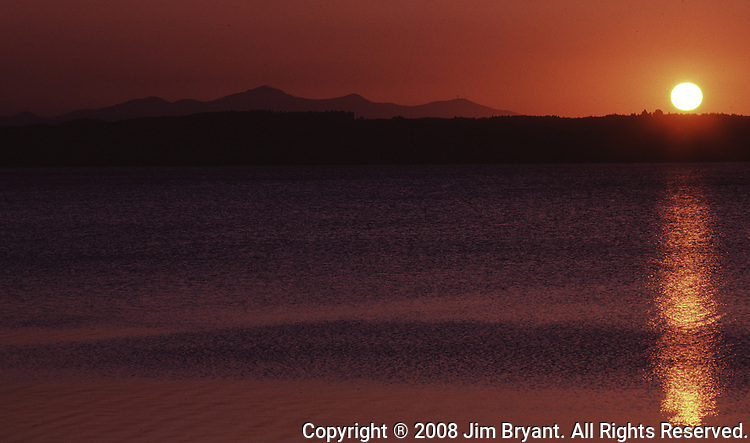 Sunset cases a beam across Lake Towada as it sinks behind the Hachimantai Mountaim Range in Aomori Prefecture on Honshu, Japan. (Jim Bryant Photo).....