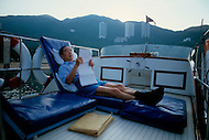 Hong Kong, China - September 25, 1981. Picture of Y.K. Pao taken aboard his yacht that sails through the Deep Water Bay Area. Y.K. Pao (November 10, 1918 - September 23, 1991) was founder of the World-Wide Shipping Group that by the mid 1970's had become the largest shipping company in the world.