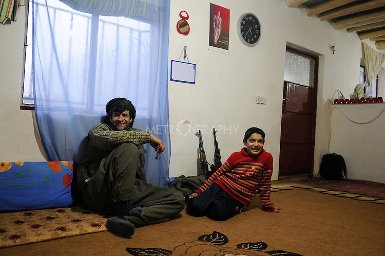 QANDIL, IRAQ:  A PKK guerrilla relaxes in a house in the Qandil mountains...The Kurdistan Workers' Party (PKK) is a pro-Kurdish party in Turkey deemed a terrorist group by the USA and the EU.  They are based in the Qandil mountains that make up the border between Iraq and Turkey...Photo by Kamaran/Najm