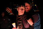 "Hundreds kept a candlelight vigil in front of the University Medical Center, where Arizona congresswoman, Gabrielle Giffords, recovers after being shot in the head on Jan. 8, 2011.  Scotty Johnson, (right), played and sang the song, ""Shower the People with Love.""  He attended the vigil with Maggie Kipling, (left)."