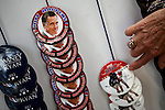 Vendors sell Mitt Romney buttons in downtown Tampa for the Republican National Convention, August 30, 2012.