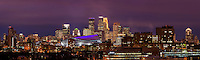USBank Stadium dressed in purple With the Minneapolis skyline lit brightly for a Minnesota Vikings Thursday Night Football game.