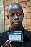 Victor Surur, 32, shows his new voter registration card in Nzara, in Southern Sudan's Western Equatoria State, on the first day of a 17-day registration period in preparation for January's referendum on secession from the country's north. Voters are expected to choose overwhelmingly for independence.