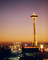 BI32,868-01...WASHINGTON - A 1965 photograph of Seattle's Space Needle towering over the civic center and the arches at the entrance of the Pacific Science Center with the Olympic Mountains in the distance.