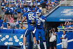 Tight end Steven Borden (85) and wide receiver Demarco Robinson (9) celebrate after Robinson scores a touchdown during the Blue/White Spring Game in Lexington, Ky., on Saturday, April 26, 2014. Blue defeated White 38-14. Photo by Adam Pennavaria | Staff