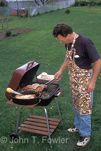 Man cooking at barbeque