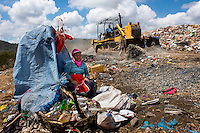 Nicaragua, Granada. Women work in the  collect recycling in massive garbage dumps for $1.00 a day.