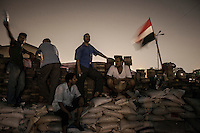 In this Friday, Aug. 02, 2013 photo, supporters of the ousted president Mohammed Morsi stand on a barricade set up at the entrance of Al-Rabaa Alawya sit-in at the Nasr City neighbourhood of Cairo. (Photo/Narciso Contreras).