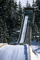 Ski Jumper jumping on Ski Jump at Whistler Olympic Park - Site of Vancouver 2010 Winter Games British Columbia Canada