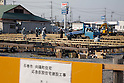 March 28, 2011, Ishonomaki, Japan - Constructions for temporary housing have started in Ishinomaki, Miyagi prefecture, on Monday, March 28, 2011. Ishinomaki, an industrial port some 350km northeast of Tokyo, is one of the hardest-hit areas in northeast Japan by the March 11 magnitude 9.0 earthquake and the subsequent 10-meter tsunami. Much of the town still remains submerged in muddy waters, which have hampered the efforts of people searching for missing kin and reconstruction. (Photo by AFLO) [3609] -mis-