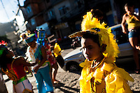 A Brazilian boy, wearing a yellow bird costume, takes part in the Carnival parade in the favela of Rocinha, Rio de Janeiro, Brazil, 20 February 2012. Rocinha, the largest shanty town in Brazil and one of the most developed in Latin America, has its own samba school called GRES Academicos da Rocinha. The Rocinha samba school is very loyal to its neighborhood. Throughout the year, the entire community actively participate in rehearsals, culture events and parades related to the carnival.
