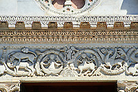 Detail of the Romanesque sculptures of the main entrance of San Michele in Foro is a Roman Catholic basilica church in Lucca, Tunscany, Italy