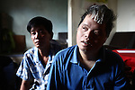 Dang Chi Tam, 42, a second generation victim of Agent Orange, sits with her brother Dang Chi Trung, 43, in their home in Da Nang, Vietnam. Their parents, now deceased, were long-time members of the Communist Party, and served in the wars against the French and Americans. Trung is the sole caregiver for his sister, who is mentally disabled and unable to speak or care for herself. &quot;Even personal hygiene she doesn't know how to do,&quot; he says. &quot;Even to go to the toilet, she doesn't know how to do.&quot; They survive on about $60 a month that is provided by the Vietnamese government. &quot;It is very difficult for us to live,&quot; he says. &quot;Because I have to care for her, I cannot go out for very long. It is very difficult for me to get a job.&quot; The Vietnam Red Cross estimates that 3 million Vietnamese suffer from illnesses related to dioxin exposure, including at least 150,000 people born with severe birth defects since the end of the war. The U.S. government is paying to clean up dioxin-contaminated soil at the Da Nang airport, which served as a major U.S. base during the conflict. But the U.S. government still denies that dioxin is to blame for widespread health problems in Vietnam and has never provided any money specifically to help the country's Agent Orange victims. May 29, 2012.