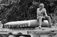June 1972, Guam --- The Andersen Air Force Base on Guam Island from where the B-52 Stratofortressplanes take off for Vietnam. Unloading bombs in a storage depot near the Andersen base. --- Image by © JP Laffont/Sygma/Corbis