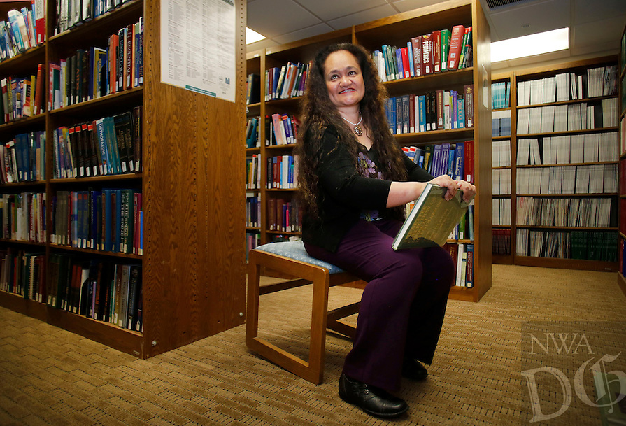 NWA Democrat-Gazette/DAVID GOTTSCHALK  Dr. Nia Aitaoto, director of the Pacific Islander Health Center through the University of Arkansas for Medical Science, in the library at the Northwest Campus, Tuesday, November 8, 2016, in Fayetteville.