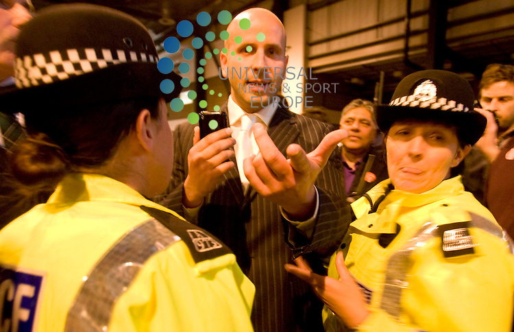 A member of the BMP is asked to stop filming on his mobile phone by Strathclyde police after complaints by asian members of the labour party during the general election count at the Scottish Exhibition Centre (SECC), Glasgow..6 May 2010 Picture: Maurice McDonald/Universal News And Sport (Europe)...