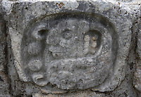 Glyph on riser of the stairway at the feet of the Five-Floor building, so called because of its five levels of vaulted rooms, Puuc architectural style, Late Classic Period, 600 - 900 AD, Edzna, Campeche, Mexico. Picture by Manuel Cohen