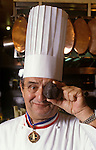Portrait of French chef Paul Bocuse in Lyon France holding a large black truffle.