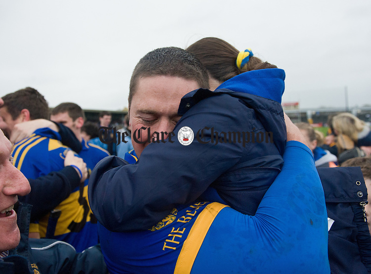 Newmarket's  Anthony Kilmartin is congratulated by his niece Jessica O Gorman at the end of the senior county hurling final at Cusack Park. Photograph by John Kelly.