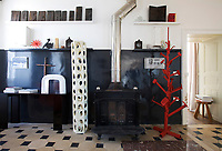 "In the entrance hall displayed on the Eric Schmitt ""Dogue"" console table and open shelves are works by Philippe Lefaure, Philippe Gronon and Salvador Dali; the red metal sculpture on the floor is by Eric Schmitt and the ceramic column by Roger Capron"