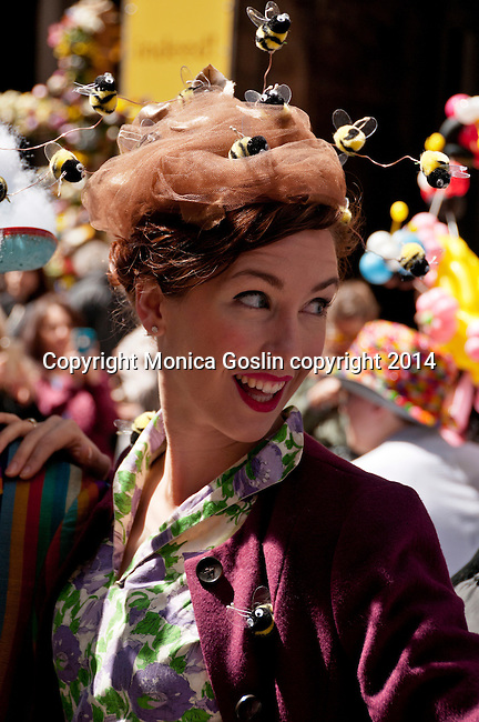Woman wearing vintage clothing and a hat with bees all over it for the Easter Parade on Fifth Avenue in New York City