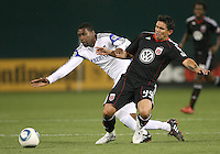 Jaime Moreno #99 of D.C.United  clashes with Pablo Escobar #6 of the Kansas City Wizards during an MLS match at RFK Stadium on May 5 2010, in Washington DC. United won 2-1