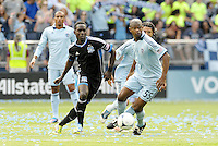 Simon Dawkins (10) San Jose forward makes a pass as Kansas City midfielder Julio Cesar watches... Sporting Kansas City defetaed San Jose Earthquakes 2-1 at LIVESTRONG Sporting Park, Kansas City, Kansas.