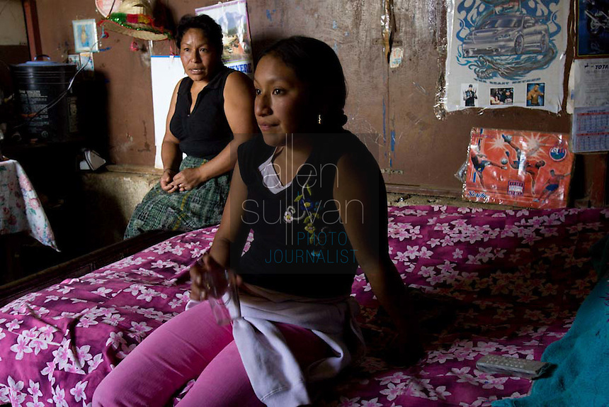 Alma de Los Angeles Sambrano Montufa, 15, sits with her mother, Miriam Violeta Montufa, and niece in their home in Chimaltenango, Guatemala on Thursday, March 8, 2007. Alma worked at Legumex, a vegetable and fruit company that exports to the United States, for a year and a half. Her mother also used to work at the plant, but can no longer work due to an illness. Both Alma and her mother say they know for certain that the plant hires underage workers for sometimes 14-hour shifts.