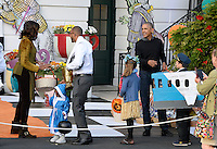 United States President Barack Obama and first lady Michelle Obama hand out treats during a Halloween event at the South Lawn of the White House October 31, 2016 in Washington, DC. The first couple hosted local children and children of military families for trick-or-treating at the White House.<br /> Credit: Olivier Douliery / Pool via CNP /MediaPunch