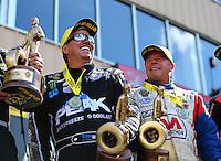 Jul 24, 2016; Morrison, CO, USA; NHRA funny car driver John Force (left) celebrates alongside pro stock driver Allen Johnson after winning the Mile High Nationals at Bandimere Speedway. Mandatory Credit: Mark J. Rebilas-USA TODAY Sports