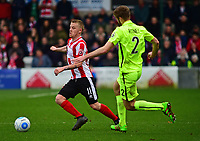 Lincoln City's Terry Hawkridge vies for possession with York City's Shaun Rooney<br /> <br /> Photographer Andrew Vaughan/CameraSport<br /> <br /> Buildbase FA Trophy Semi Final Second Leg - Lincoln City v York City - Saturday 18th March 2017 - Sincil Bank - Lincoln<br />  <br /> World Copyright &copy; 2017 CameraSport. All rights reserved. 43 Linden Ave. Countesthorpe. Leicester. England. LE8 5PG - Tel: +44 (0) 116 277 4147 - admin@camerasport.com - www.camerasport.com