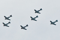 Six vintage World War II planes flown by pilots from the Condor Squadron of Van Nuys fly above Santa Monica on Saturday, September 22, 2012. The Condor Squadron was founded in 1965 by aviation enthusiasts dedicated to preserving the memory of those who have served the nation over the years. Memorial flights in restored North American aircraft originally flown during World War II are among the group's primary activities that also include parade appearances.