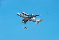 Space shuttle Endeavour over Los Angeles CA, riding piggyback aboard NASA's modified Boeing 747 Shuttle Carrier Aircraft.