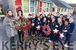 Children from third to sixth class in St John's Parochial School Ashe Street pictured with Eleanor Groves from Eleanor's Florists Tralee and Aoife Benton (Principal) announcing details of their fundraising flower demonstration taking place on Friday November 25th.