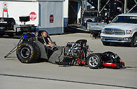 Sept. 29, 2012; Madison, IL, USA: NHRA crew member drives the car of funny car driver Terry Haddock after blowing the body off during qualifying for the Midwest Nationals at Gateway Motorsports Park. Mandatory Credit: Mark J. Rebilas-