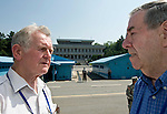 British Korean War veterans John Lees from Telford (left) and Robison Brown from Concett, County Durham,  chat on the South Korea side of the demilitarized zone -- with North Korea visible in the background -- in Panmunjom (the de facto border between North and South Korea), South Korea on 24 June 2010..Photographer: Rob Gilhooly