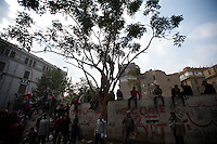 A group of protestor gather near a area where clashes with the security forces have occurred in previous days.
