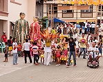 Locals arrive at Sampaloc's central municipal plaza as the Bulihan Festival begins.  (Sampaloc, Quezon Province, the Philippines.)